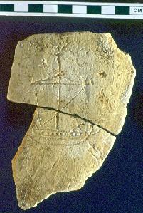 Restos de cerámica con una imagen de un barco